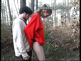 Legal age teenager sucks boyfriend in forest
