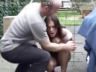 Two girls fight wide a jalopy junkyard
